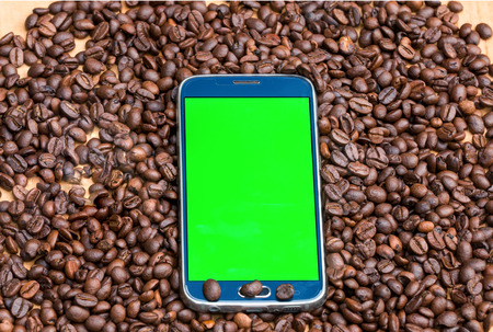 green screen: green screen smart phone on coffee beans  background