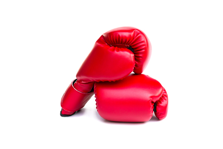 violence in sports: Pair of red leather boxing gloves on white background