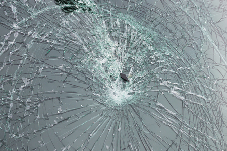 triplex: Closeup of car with broken windshield Stock Photo