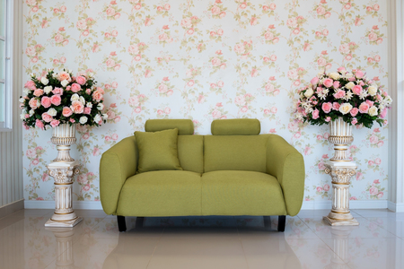 green couch: Classic living-room interior with green couch and flower