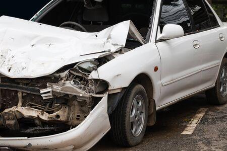 totaled: car crash accident on street, damaged automobile