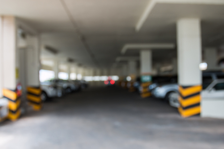 valet: Out of focus office building valet parking area background