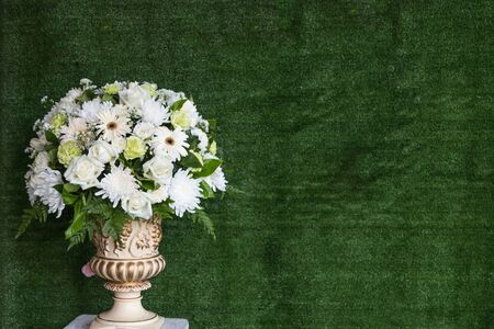 green back: Decorative artificial flowers on green back ground