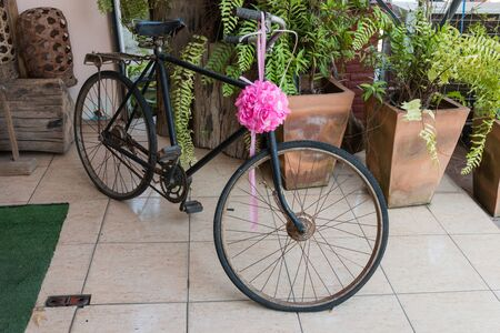 decorated bike: Vintage bicycle with flower decorations