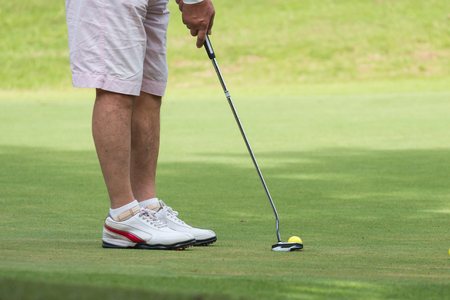 rivals rival rivalry season: Golfer making the perfect putt Stock Photo