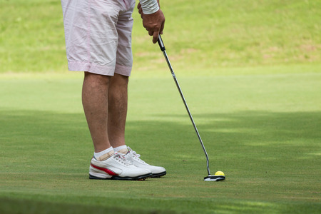 putt: Golfer making the perfect putt Stock Photo