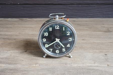 Still life alarm clock on wood table Stock Photo
