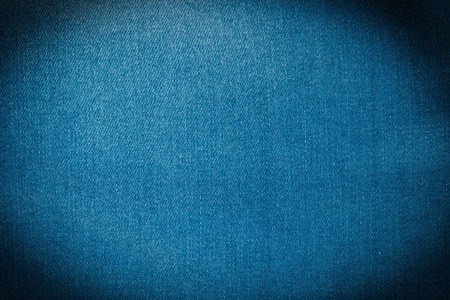 sewn up: close up of  blue jeans texture