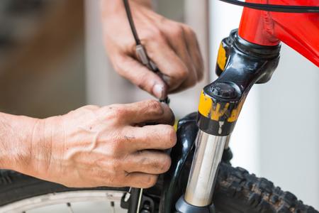 mechanic repair bicycle in workshop