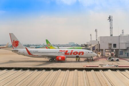 BANGKOK, THAILAND -FEBRUARY 25, 2017 : Aircraft of the Lion Air airline waiting for passengers at Don Mueang International Airport, Bangkok, Thailand.