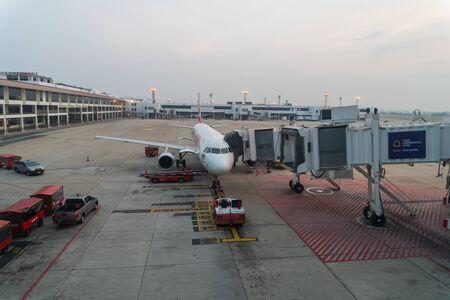 BANGKOK, THAILAND -FEBRUARY 26, 2017 : Aircraft of the Lion Air airline waiting for passengers at Don Mueang International Airport, Bangkok, Thailand.