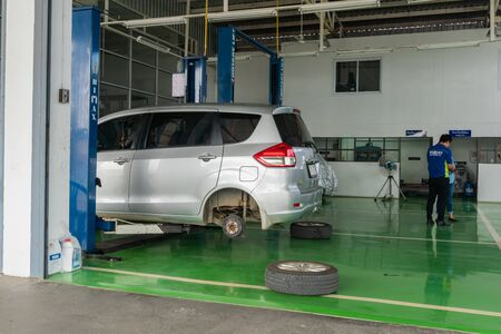 SUKHOTHAI - NOVEMBER 23: mechanic repairing car at Suzuki Motor Service station on November 23, 2018 in Sukhothai, Thailand