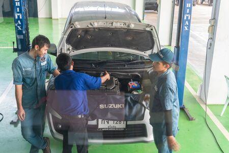 SUKHOTHAI - NOVEMBER 23 : mechanic repairing car at Suzuki Motor Service station on November 23, 2018 in Sukhothai, Thailand
