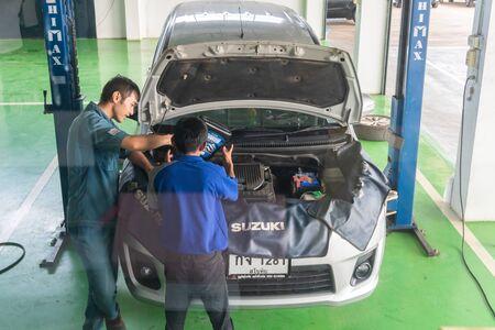 SUKHOTHAI - NOVEMBER 23:mechanic repairing car at Suzuki Motor Service station on November 23, 2018 in Sukhothai, Thailand