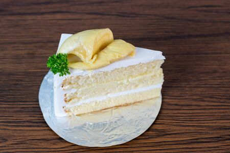 fresh  durian on Durian cake on brown wooden background