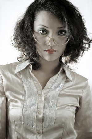 Portrait of two asian girl with curly hair wearing a formal shirt with old glasses in the studio  photo
