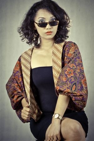 Portrait asia girl with curly hair wearing traditional regional costumes from Indonesia  photo