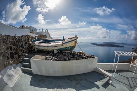 fish eye lens: Old boat on the island of Santorini, Greece. Photographing Fish eye lens
