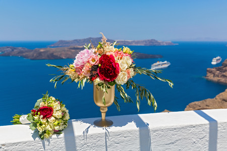 Large Vase With Flowers And Bouquet On The Wall Against The Sea