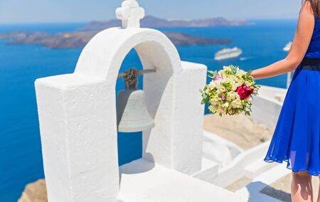 dais: Woman with bouquet on the dais of island  Santorini Stock Photo