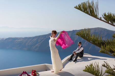 love dome: Young couple couple on the roof of the buildings of Santorini, Greece