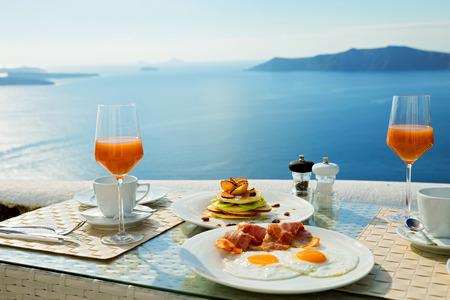 Fresh juice and  Breakfast on the shore of the blue sea, Greece, Santorini.
