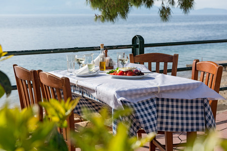 Lunch in a restaurant overlooking the sea, Greece, Santorini Stock Photo
