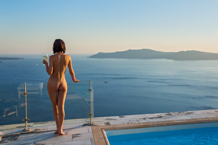 Young woman sunbathing Nude, seen from behind