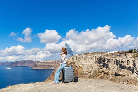 Young woman with suitcase rejoice in the arrival of the sea