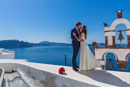 love dome: Wedding couple  on the background   island Santorini Stock Photo