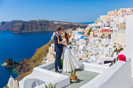 Wedding couple  on the background architecture of Santorini