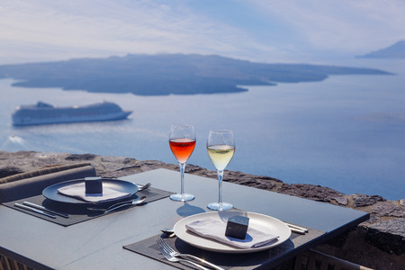 Two glasses of wine on the background of sea evening, Greece Standard-Bild