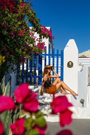 Beautiful woman at the entrance to the Greek house Stock Photo - 115812988