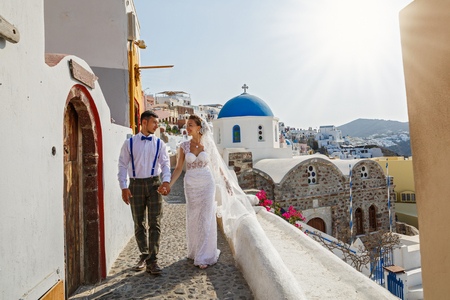 Young couple on the background of the architecture in Santorini