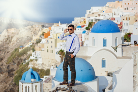 Young groom on the background of sea and architecture, Santorini island Greece Stock Photo
