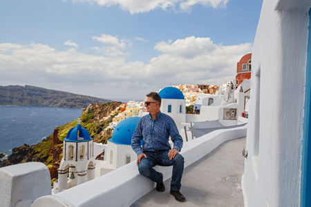 Man travels and looks at the landscape of Santorini