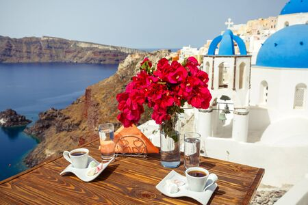 Coffee and Breakfast for two on the beach of Santorini