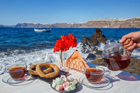 Picnic on the beach with tea and fresh pastries