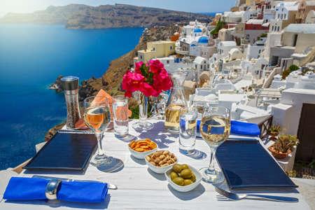 White wine and snacks by the sea in Greece, Santorini island