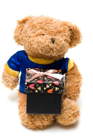 toy bear hold a hand-made black gift box  in white background photo