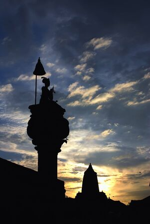 godliness: ancient sculpture under beautiful sunset of durbar square, nepal Stock Photo