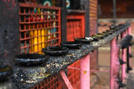 godliness: Candlestick of nepal temple in patan durbar square. Stock Photo