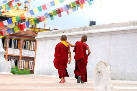 cassock: Two Tibetan Children Buddhist Monks walking Stock Photo