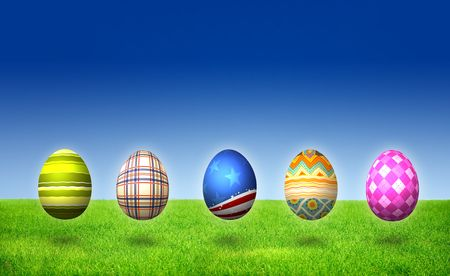 Easter Eggs on grass field under clear blue sky Stock Photo - 6669675