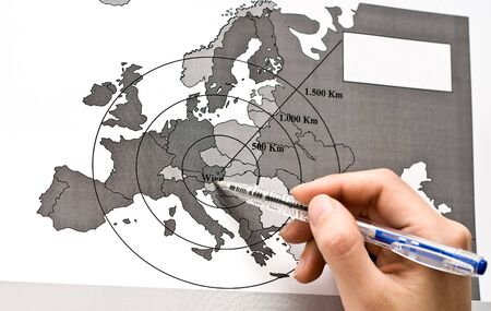 Vienna on Europe map with a human hand of studio shot photo