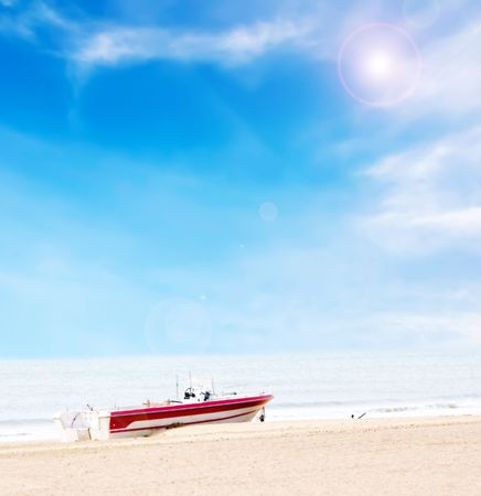 Beautiful boat on beach under blue sky and clouds with high light processing photo