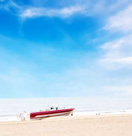 stock image: Beautiful boat on beach under blue sky and clouds with high light processing Stock Photo
