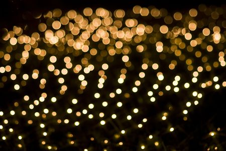 holiday lighting: Defocused yellow light effect against black background Stock Photo