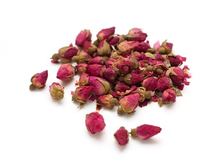 Natural dried rose tea isolated on white background