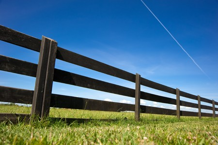 Wooden Fence Under Blue Sky
